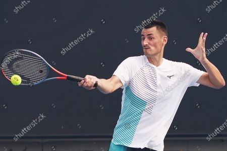 Stock Photo of Bernard Tomic of Australia hits a forehand in his qualifying match against Denis Kudla of the USA ahead of the Australian Open 2020 at Melbourne Park in Melbourne, Victoria, Australia, 14 January 2020. The Australian Open 2020 will take place at Melbourne Park from 20 January to 02 February.