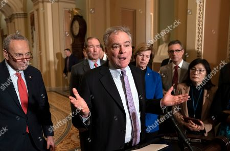 Chuck Schumer, Tim Kaine, Tom Udall, Tammy Baldwin. Sen. Tim Kaine, D-Va., center, joined from left by Senate Minority Leader Chuck Schumer, D-N.Y., Sen. Tom Udall, D-N.M., and Sen. Tammy Baldwin, D-Wis., meets with reporters as the House prepares to send the articles of impeachment against President Donald Trump to the Senate, at the Capitol in Washington