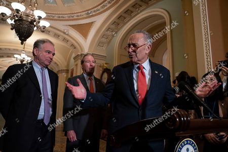 Stock Image of Chuck Schumer, Tim Kaine, Tom Udall. Senate Minority Leader Chuck Schumer, D-N.Y., joined by Sen. Tim Kaine, D-Va., and Sen. Tom Udall, D-N.M., meets with reporters as the House prepares to send the articles of impeachment against President Donald Trump to the Senate, at the Capitol in Washington