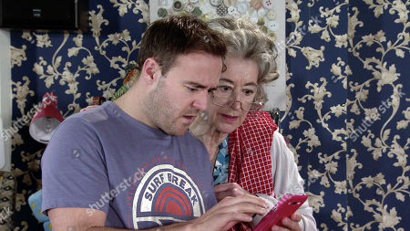 Coronation Street - Ep 9984 Monday 20th January 2020 - 1st Ep As Hope Stape and Ruby fight over a toy handbag a mobile phone falls out. Scrolling through the messages Tyrone Dobbs, as played by Alan Halsall, realises with horror that Jade must have given Hope the phone. Reading a message promising Hope they'll be together soon, Tyrone and Evelyn Plummer, as played by Maureen Lipman, stare at each other in shock.