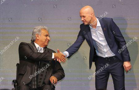 Ecuador's President Lenin Moreno, left, welcomes Jordi Cruyff as Ecuador's new national soccer coach in Quito, Ecuador, . Cruyff is the Dutch son of the legendary soccer player Johan Cruyff