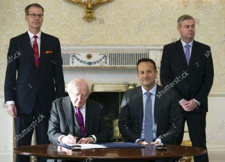 Irish Taoiseach Leo Varadkar (R) looks as Irish President Michael D Higgins (L) signs the request of dissolving the Irish Parliament in Dublin, Ireland, 14 January 2020. The general election in Ireland will be held on 08 February 2020.