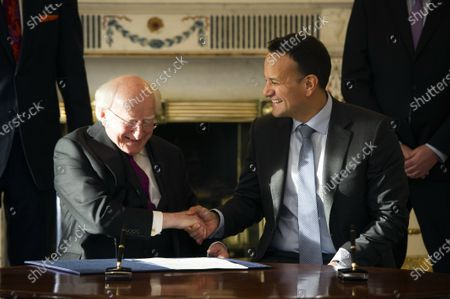 Irish Taoiseach Leo Varadkar (R) shakes hands with Irish President Michael D Higgins (L) after requesting dissolving the Irish Parliament in Dublin, Ireland,  14 January 2020. The general election in Ireland will be held on 08 February 2020.