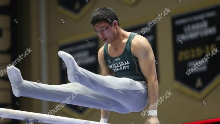 Stock Picture of Willam & Mary's Spencer Schrandt performs on the parallel bars during the West Point Open NCAA gymnastics meet, in West Point, N.Y