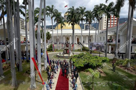 Venezuela's President Nicolas Maduro, first lady Cilia Flores and Constituent Assembly President Diosdado Cabello arrive to the grounds of the National Assembly where Maduro will give his annual address to the nation inside the chamber of the Constituent Assembly in Caracas, Venezuela