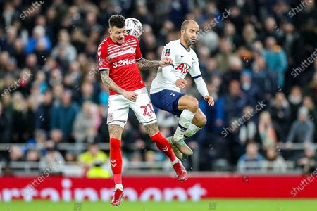 Tottenham Hotspur midfielder Lucas Moura (27) and Middlesbrough midfielder Marvin Johnson (21) clash in the air during the The FA Cup third round replay match between Tottenham Hotspur and Middlesbrough at Tottenham Hotspur Stadium, London