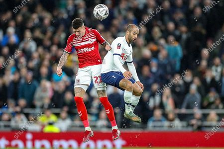 Middlesbrough midfielder Marvin Johnson (21) and Tottenham Hotspur midfielder Lucas Moura (27) clash in the air during the FA Cup third round replay match between Tottenham Hotspur and Middlesbrough at Tottenham Hotspur Stadium, London