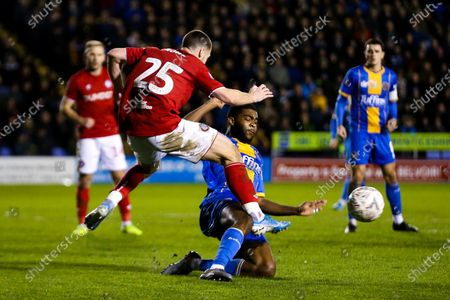 Tommy Rowe of Bristol City is tackled by Ro-Shaun Williams of Shrewsbury Town