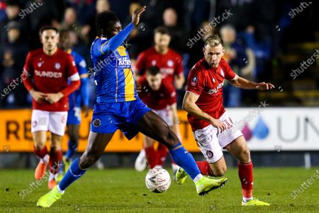 Stock Picture of Andi Weimann of Bristol City is challenged by Aaron Pierre of Shrewsbury Town