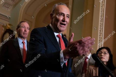 Chuck Schumer, Tom Udall. Senate Minority Leader Chuck Schumer, D-N.Y., joined at left by Sen. Tom Udall, D-N.M., meets with reporters as the House prepares to send the articles of impeachment against President Donald Trump to the Senate, at the Capitol in Washington