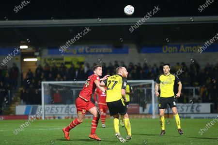 Liam Boyce of Burton Albion (27) and Joe Walsh of Milton Keynes Dons (4)  during the The FA Cup third round replay match between Burton Albion and Milton Keynes Dons at the Pirelli Stadium, Burton upon Trent
