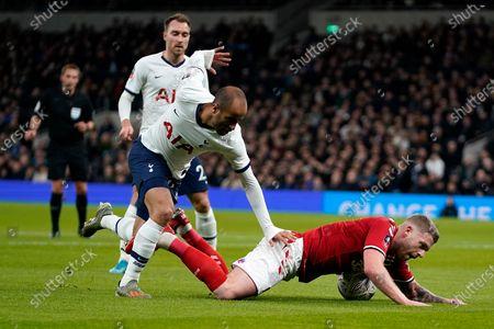 Tottenham's Lucas Moura (C) vies for the ball against Middlesborough's Adam Clayton (R) during their FA Cup third round soccer match at Tottenham Hotspur Stadium, London, Britain, 14 January 2020.