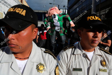 People protest where outgoing President Jimmy Morales is sworn-in as a member of the Central American Parliament in Guatemala City, . Guatemala will swear-in on Tuesday a new president as Morales exits amid swirling corruption accusations