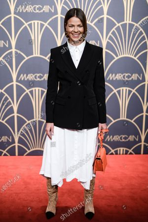 German actress Jessica Schwarz poses on the red carpet prior the Marc Cain fashion show during the Berlin Fashion Week, in Berlin, Germany, 14 January 2020. The Berlin Fashion Week presents creations of the Fall/Winter 2020 collections and runs from 13 to 17 January.