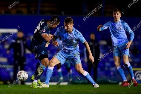 Jonson Clarke-Harris of Bristol Rovers challenges Kyle McFadzean of Coventry City