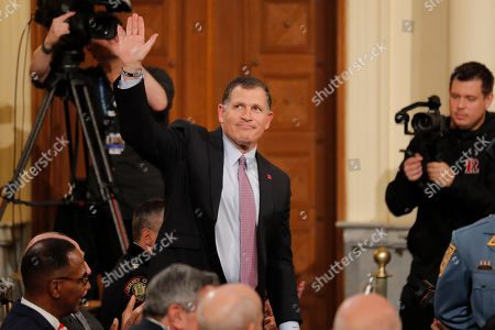 Rutgers' football coach Greg Schiano waves as he is mentioned by New Jersey Gov. Phil Murphy during the State of the State address in Trenton, N.J., . Murphy, a Democrat, delivered his second State of the State speech Tuesday before a joint session of the Democrat-led Legislature, sketching his agenda for the year