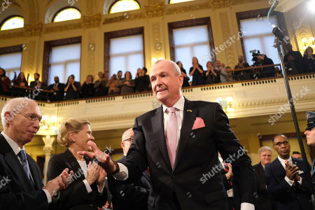 New Jersey Gov. Phil Murphy greets people before his State of the State address in Trenton, N.J., . Murphy, a Democrat, delivered his second State of the State speech Tuesday before a joint session of the Democrat-led Legislature, sketching his agenda for the year