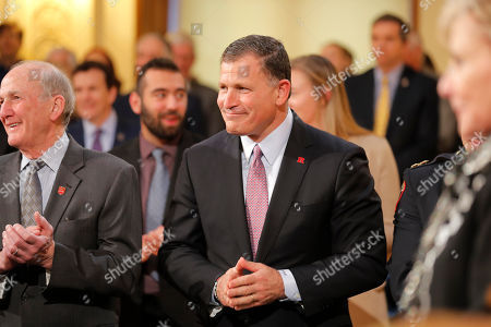Rutger's football coach Greg Schiano smiles before the start of New Jersey Gov. Phil Murphy's State of the State address in Trenton, N.J., . Murphy, a Democrat, delivered his second State of the State speech Tuesday before a joint session of the Democrat-led Legislature, sketching his agenda for the year
