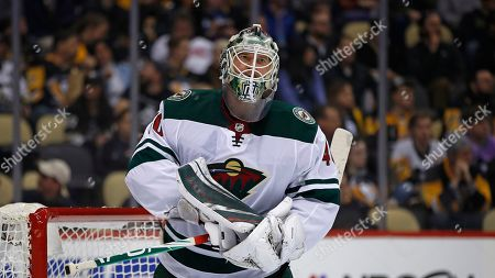 Minnesota Wild goaltender Devan Dubnyk takes a timeout during the second period of an NHL hockey game against the Pittsburgh Penguins in Pittsburgh