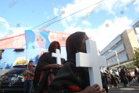 Protesters arrive in front of the Central American Parliament (Parlacen) in Guatemala City, Guatemala, 14 January 2020, to protest against outgoing President Jimmy Morales over the fire at an orphanage that killed 41 girls on 08 March 2017, at the Virgen de la Asuncion Safe Home in San Jose Pinula. Morales would assume a position in the Parlacen at the end of his presidential term.
