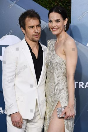 Stock Picture of Sam Rockwell and Leslie Bibb