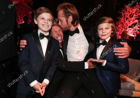 Stock Photo of Nicholas Crovetti, Jack McBrayer, Alexander Skarsgard and Cameron Crovetti