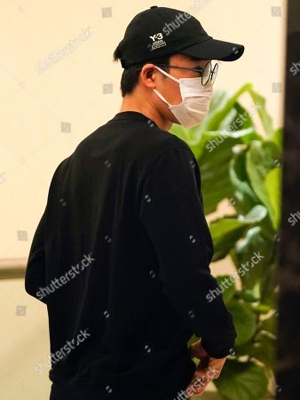 Japanese badminton player Kento Momota arrives at Kuala Lumpur International airport in Sepang, Malaysia, . Badminton men's singles world champion and world number one Momota was injured at a traffic accident Monday