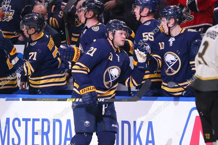 Buffalo Sabres forward Kyle Okposo (21) celebrates his goal during the second period of an NHL hockey game against the Vegas Golden Knights, in Buffalo, N.Y