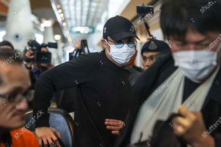 World number one badminton player, Kento Momota (C) of Japan arrives at Kuala Lumpur International Airport (KLIA) as he waits his flight to Japan, in Sepang, Malaysia, 15 January 2020. According to media reports, world number one badminton player,  Kento Momota, suffered a broken nose and received stitches in his lips following a deadly crash between a van and a truck in Kuala Lumpur on 13 January.