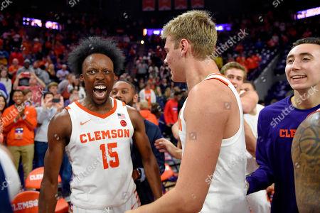 Clemson's John Newman lll, left, celebrates with Parker Fox after an NCAA college basketball game against Duke, in Clemson, S.C. Clemson won 79-72