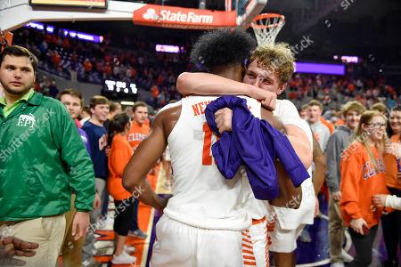 Clemson's John Newman lll, back, celebrates with Wells Hoag after an NCAA college basketball game against Duke, in Clemson, S.C. Clemson won 79-72