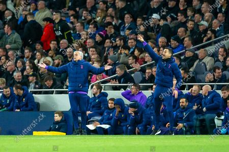 Tottenham Hotspur Manager Jose Mourinho throws his arms out wide in frustration and member of the Tottenham coaching staff João Sacremento shouts from the Trechnical Area