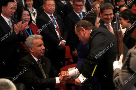 The President of Ecuador Lenin Moreno (L) attends the inauguration of the president-elect of Guatemala, Alejandro Giammattei (not pictured), at the National Theater in Guatemala City, Guatemala, 14 January 2020.