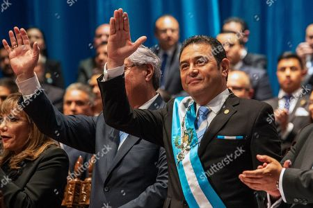 Outgoing Guatemalan President Jimmy Morales waves during the swearing-in ceremony for new President Alejandro Giammattei at the National Theater in Guatemala City, . Giammattei, a conservative physician opposed to gay marriage and abortion, became Guatemala's new president, while the country's outgoing leader exits amid swirling corruption accusations