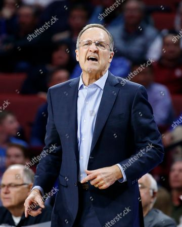 Oklahoma coach Lon Kruger shouts during the second half of the team's NCAA college basketball game against Kansas in Norman, Okla