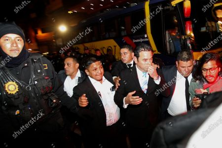 Former Guatemalan president Jimmy Morales (C-R) cannot access the hotel where his inauguration as deputy of the PARLACEN, or Central American Parliament, is scheduled to take place, as demonstrators block the way, in Guatemala City, Guatemala, 14 January 2020.