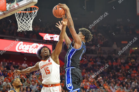 Duke's Vernon Carey Jr. shoots while defended by Clemson's John Newman lll during the second half of an NCAA college basketball game, in Clemson, S.C. Clemson won 79-72