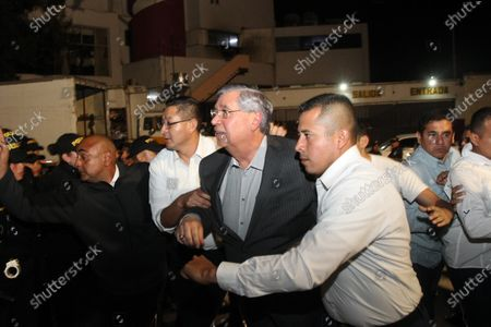Stock Image of Outgoing Guatemalan President Jafeth Cabrera (C) is escorted after his second attempt to attend the Parliament's session in Guatemala City, Guatemala, 14 January 2020 (issued on 15 January 2020). Cabrera managed to be sworn in as MP in Parliament, a move that will allow him to keep exemption from prosecution for alleged charges of corruption and illegal election funding.