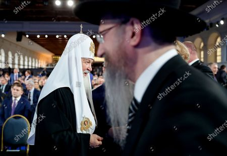 Stock Photo of Russian Orthodox Patriarch of Moscow and All Russia Kirill (L) and  Russia's chief rabbi Berel Lazar (R) attend Russian President Vladimir Putin's annual address to the Federal Assembly at the Manezh Central Exhibition Hall in Moscow, Russia, 15 January 2020. About 1,300 people including lawmakers of Russian two-chamber parliament, Government members, heads of the Constitutional and Supreme courts, and regional governors, were invited to attend the event. About 900 Russian and foreign journalists were accredited to cover the event.