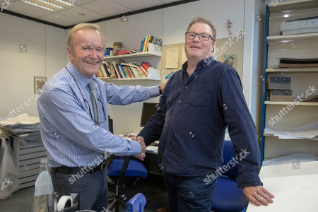 Stock Picture of Features - Daily Mail Cartoonist Mac ( Stanley Mcmurtry) And His Successor Paul Thomas In Mac's Studio.