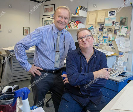 Editorial picture of Daily Mail Cartoonist Mac ( Stanley Mcmurtry) And His Successor Paul Thomas In Mac's Studio.