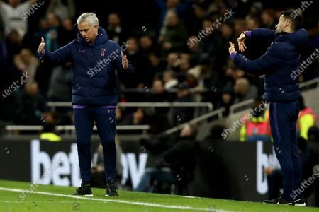 Tottenham Hotspur Manager Jose Mourinho and his assistant give out instructions to their players