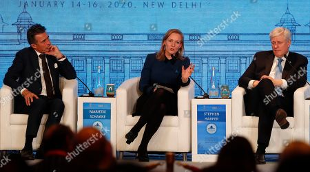 Stock Image of Marietje Schaake, Stephen Harper, Anders Rasmussen. President Cyberspace Institute, Netherlands, Marietje Schaake, center, speaks at a global conference as former Prime Ministers of Canada Stephen Harper, right, and former Danish prime minister Anders Rasmussen listens in New Delhi, India