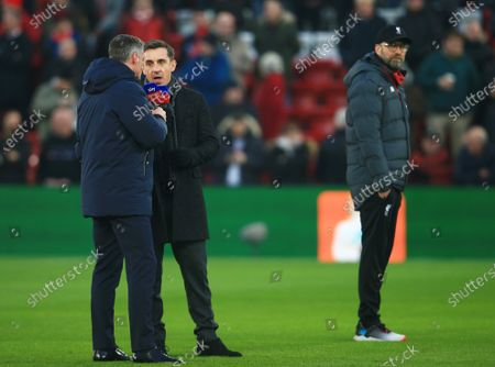 Gary Neville and Jamie Carragher on the pitch ahead of the game alongside Liverpool manager Jurgen Klopp