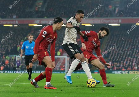 Anthony Martial of Manchester United in between Mohamed Salah and Trent Alexander Arnold of Liverpool