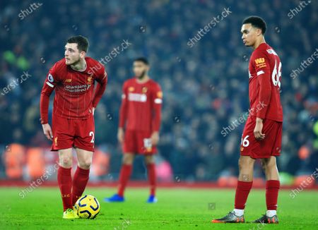Andrew Robertson and Trent Alexander Arnold of Liverpool prepare to take a free kick