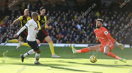 Ben Foster of Watford makes a save under pressure from  Lucas Moura of Tottenham Hotspur