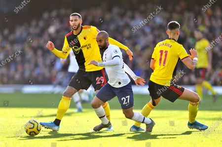 Lucas Moura of Tottenham Hotspur  battles with Etienne Capoue of Watford and Adam Masina of Watford