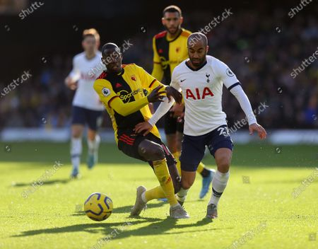 Abdoulaye Doucoure of Watford battles with  Lucas Moura of Tottenham Hotspur
