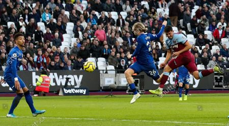 Pablo Fornals of West Ham (R)gets ahead of Tom Davies of Everton to get good contact on a header before Goalkeeper Jordan Pickford of Everton pulls of a great save flicking the ball over the bar on the stroke of half time.